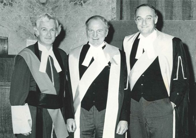 Black and white image of three men in judges robes
